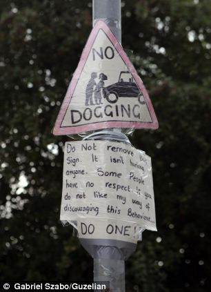 Marie Owen has put up a 'no dogging' sign outside her home after becoming fed up with people meeting on the street for sex.  Read more: http://www.dailymail.co.uk/news/article-2430455/Livid-mother-puts-dogging-sign-outside-home-plagued-people-meeting-sex.html